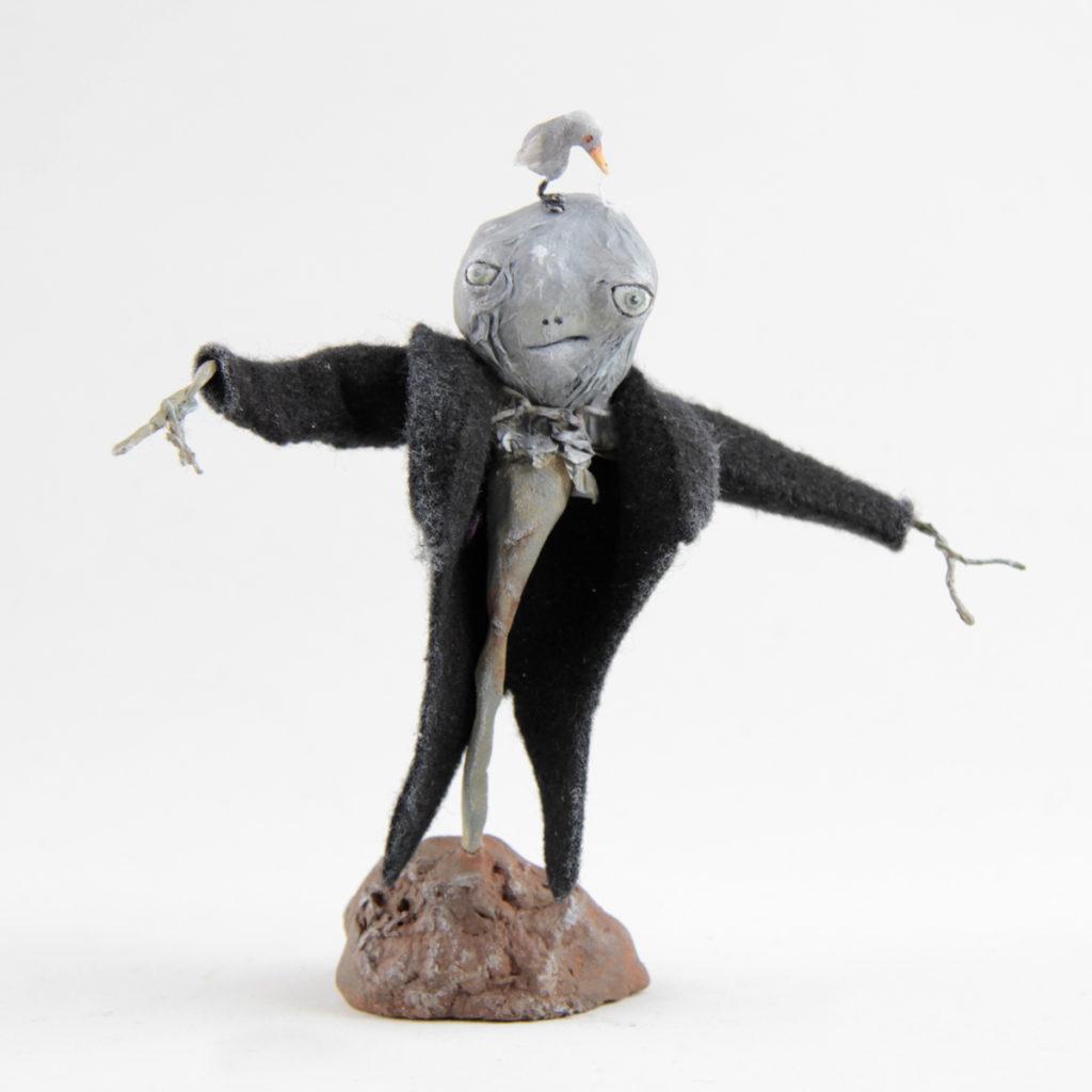 Scarecrow and a bird